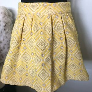 Yellow brocade skirt with pockets